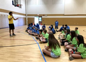 Youth For Christ Area Director, Josh McCoy, speaks to students in the gym at Middle School Madness 2021.