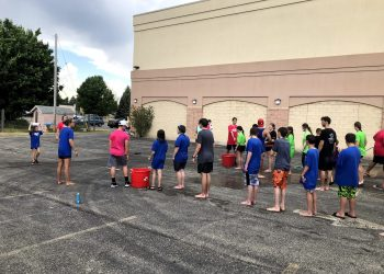 Students line up to participate in the water activity at Middle School Madness 2021.
